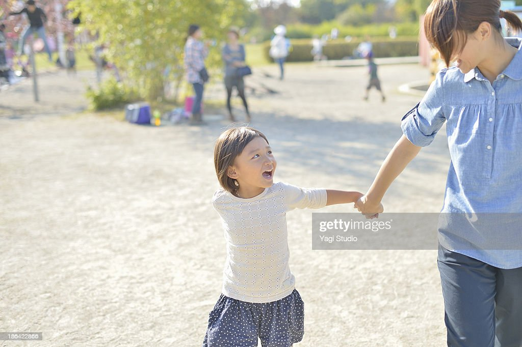 Mother and daughter playing in the park : Stock Photo