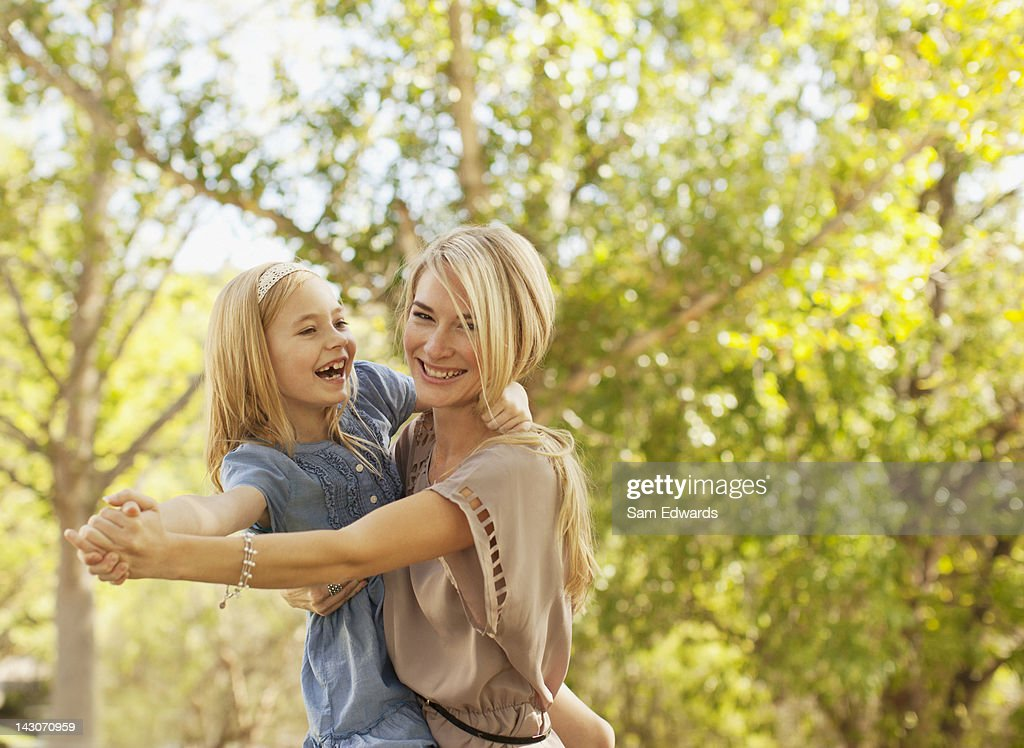 Mother and daughter playing outdoors : Stock Photo