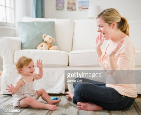 Mother and daughter playing together : Stock Photo