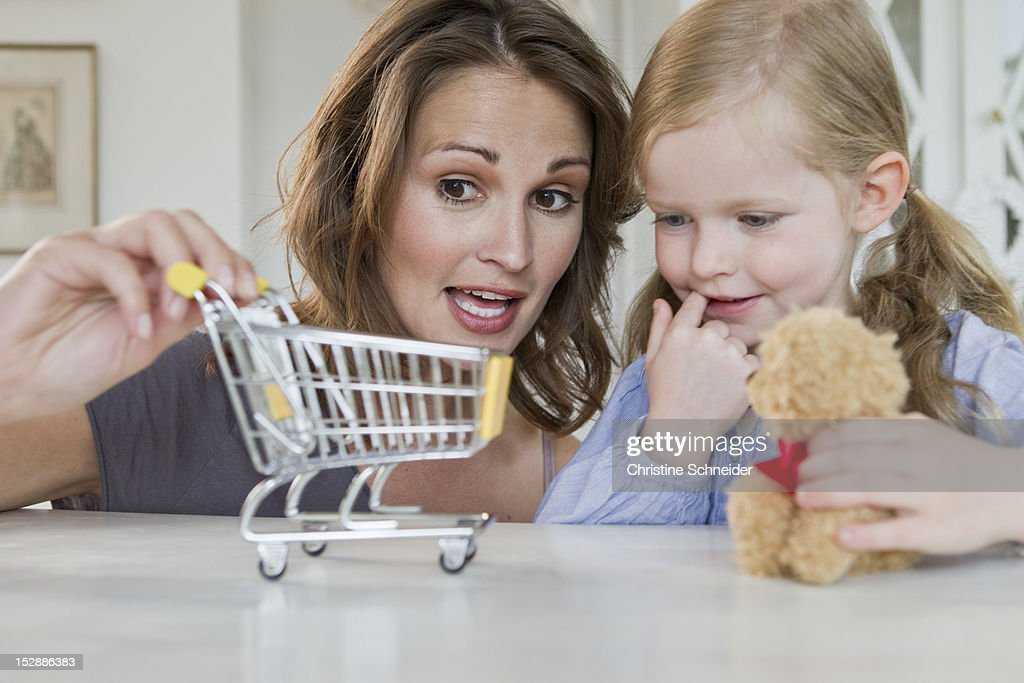 Mother and daughter playing with toys : Stock Photo