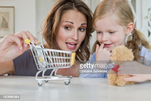 Mother and daughter playing with toys : ストックフォト