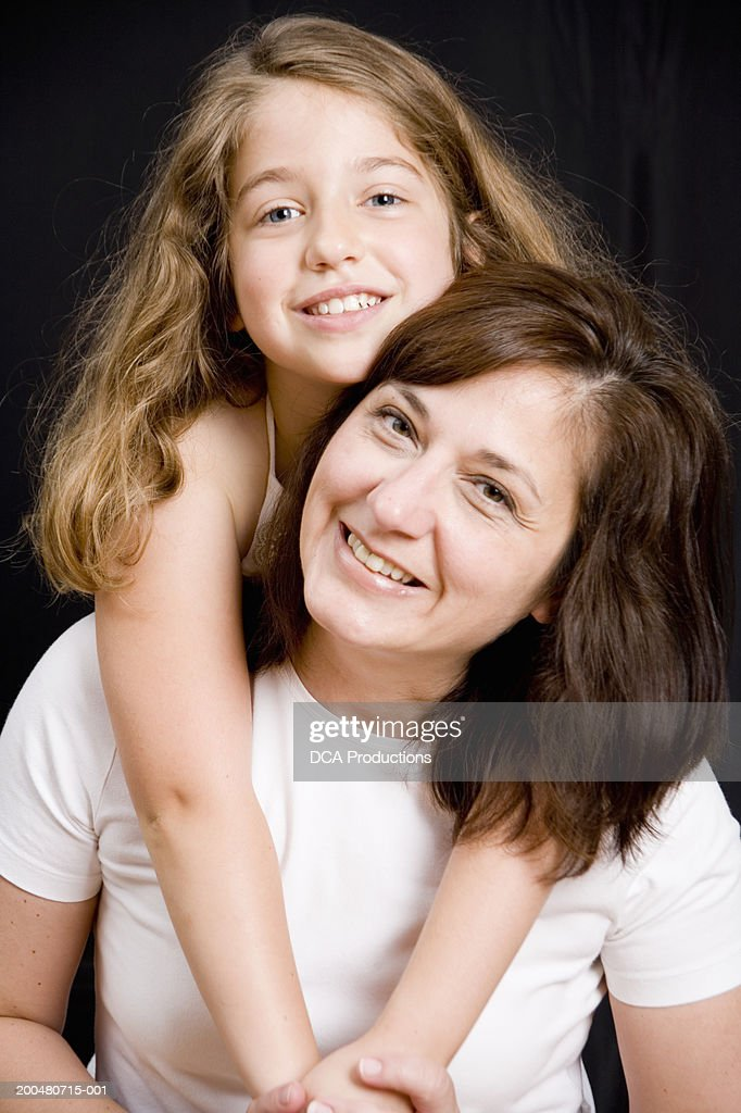 Mother and daughter (6-8), portrait