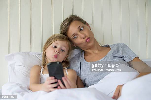 Mother and daughter posing for selfie