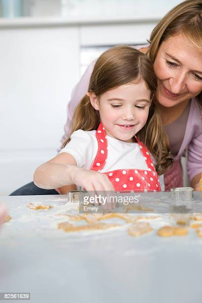 Mother and daughter preparing cookies