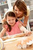 Mother and daughter preparing food