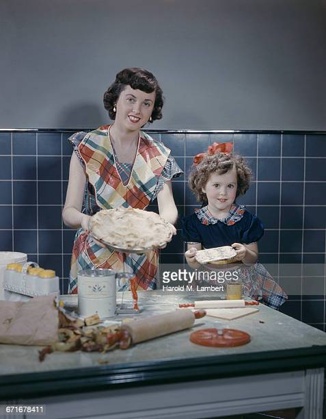Mother And Daughter Preparing Food Together In Kitchen