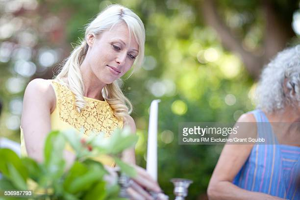 Mother and daughter preparing garden party table