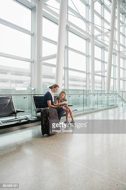 A mother and daughter reading a book