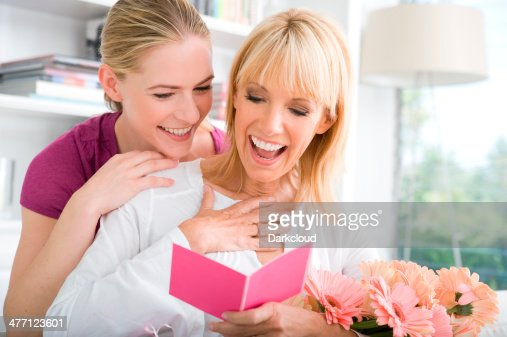 Mother and daughter reading a card
