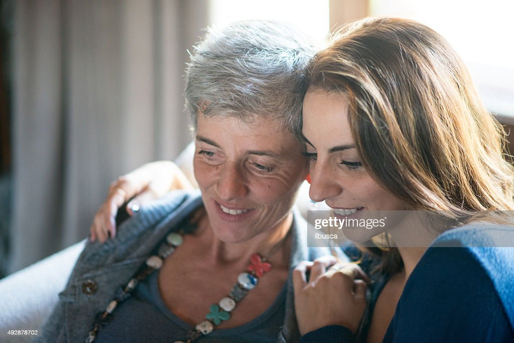 Mother and daughter reading together : Stock Photo