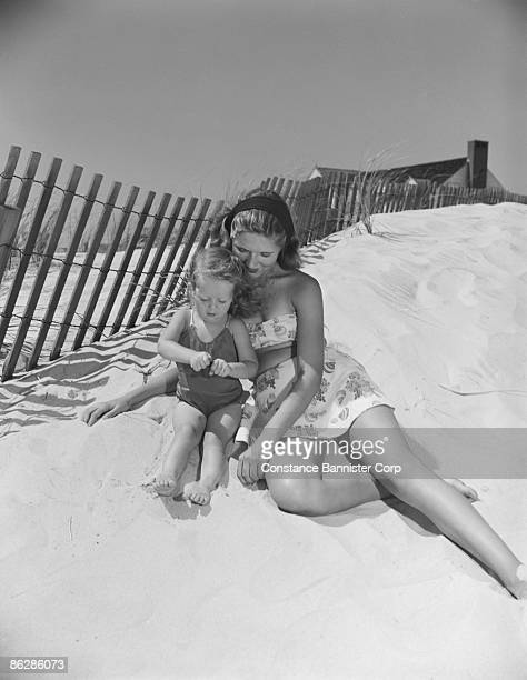Mother and daughter relaxing at beach