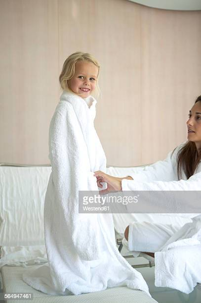 Mother and daughter relaxing in hotel spa