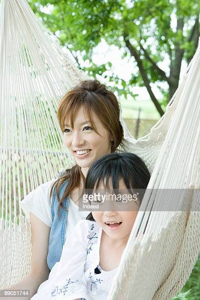Mother and daughter relaxing on hammock
