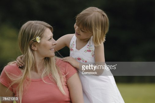 Mother and daughter relaxing outdoors : Stock Photo