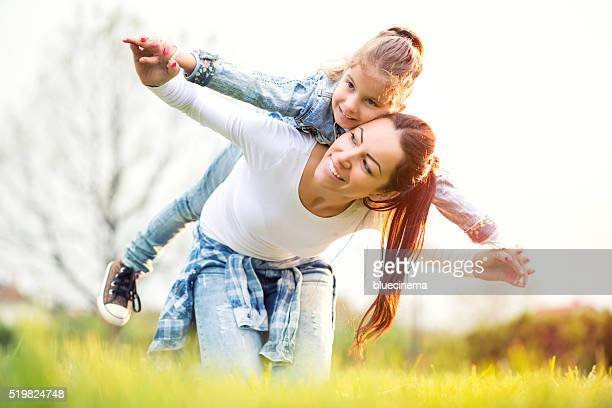 Mother and daughter relaxing together outdoor.