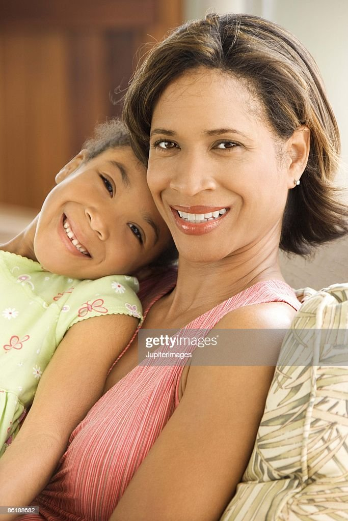 Mother and daughter relaxing together : Stock Photo
