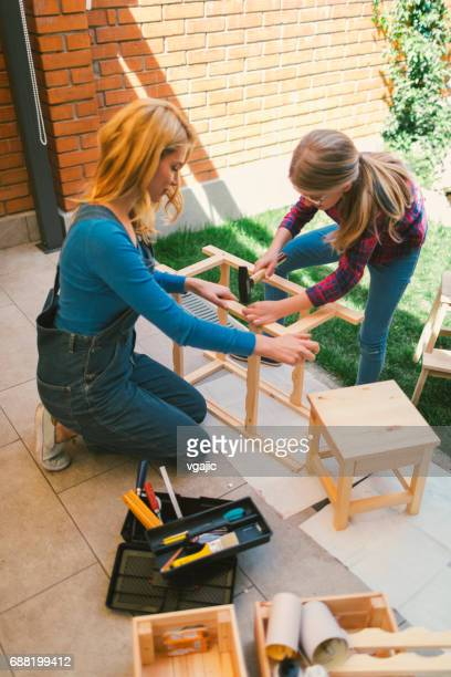 Mother And Daughter repairing furniture