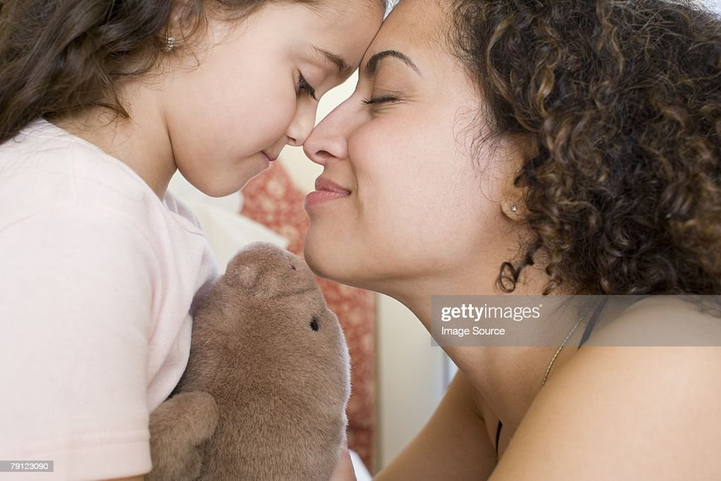 Mother and daughter rubbing noses : Stock Photo