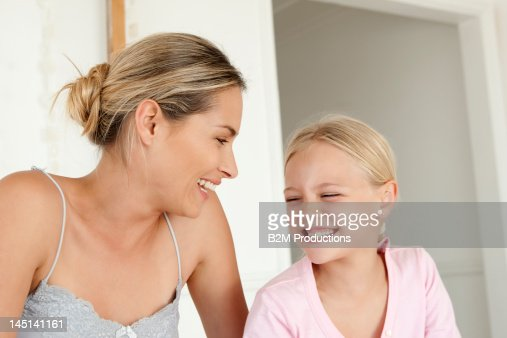 Mother and daughter sharing a joke : Stock Photo