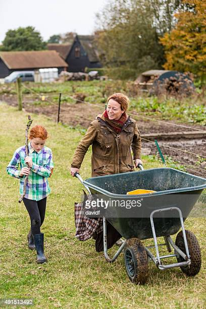 Mother and Daughter Sharing Moment While Working an Organic Farm