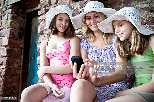 Mother and daughter sharing smartphone