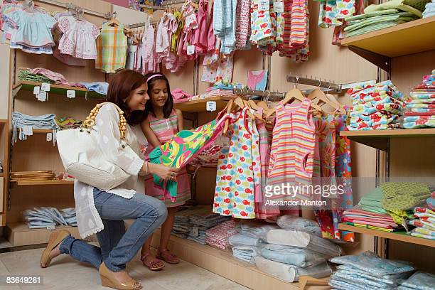mother and daughter shopping for clothes