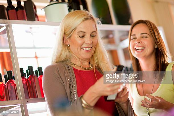 Mother and daughter shopping for vinegar