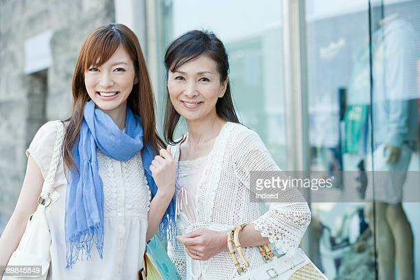 Mother and daughter shopping, portrait