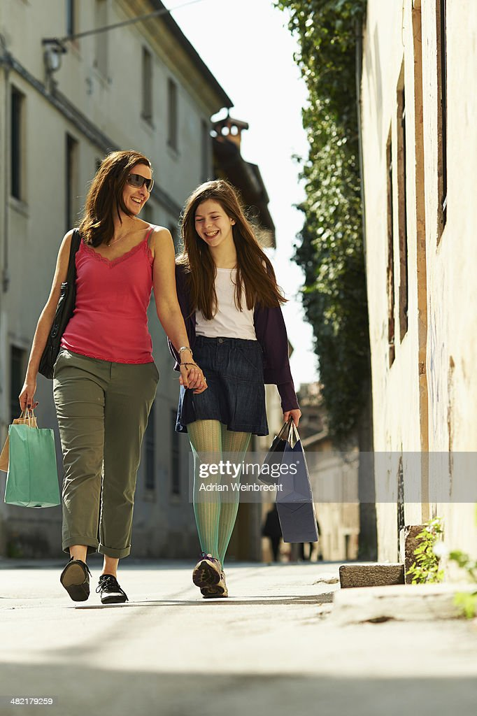 Mother and daughter shopping, Province of Venice, Italy : Stock Photo