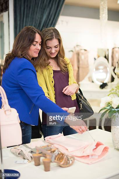 mother and daughter shopping with a smartphone .