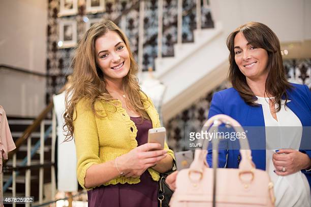 mother and daughter shopping with qr codes