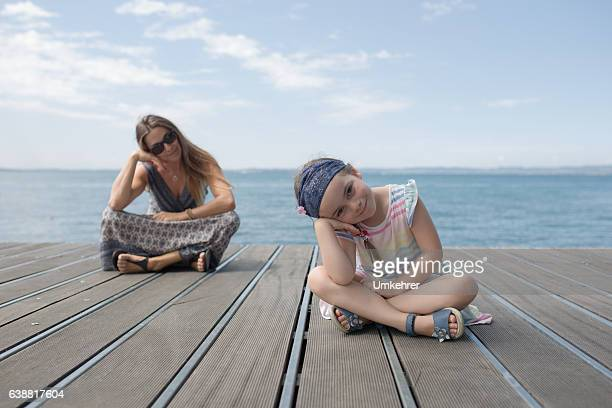 Mother and daughter sit on a web