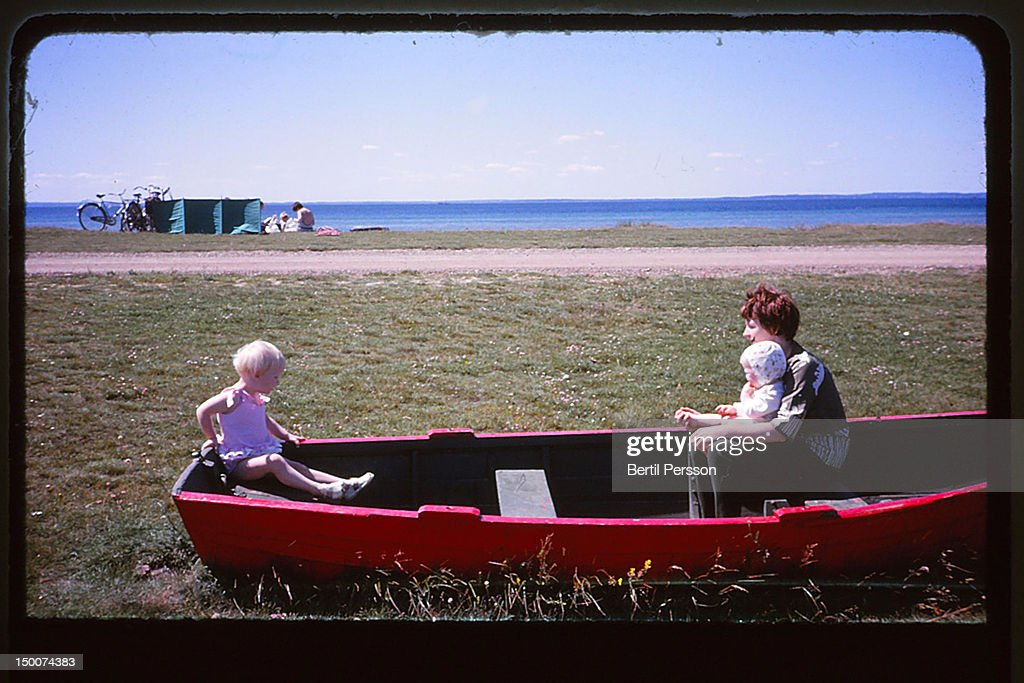 Mother and daughter sitting in rowing boat : Stock Photo