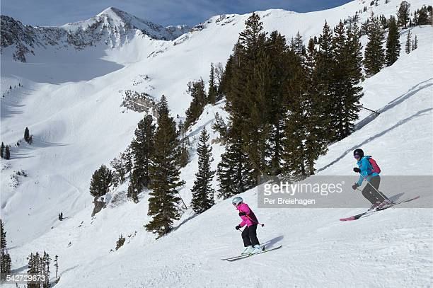 Mother and daughter skiing down the mountain, Utah