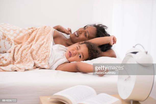 Mother and daughter sleep late.