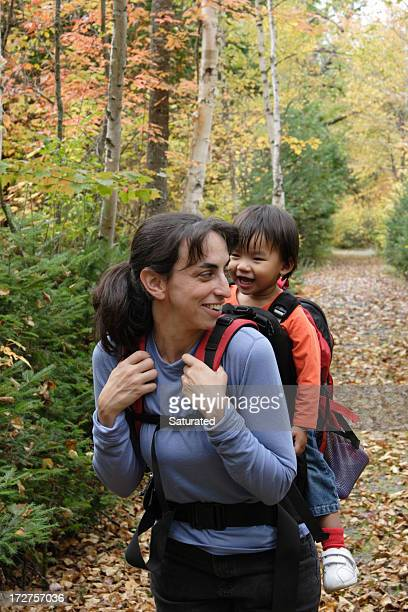 Mother and Daughter Smiling At Each Other While Hiking