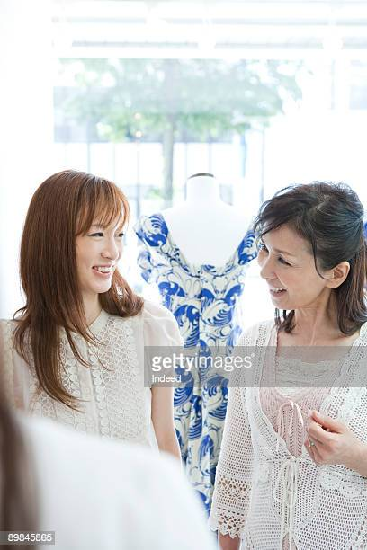 Mother and daughter smiling in clothing store