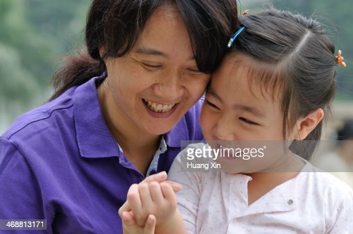 Mother and Daughter Smiling : Stock Photo