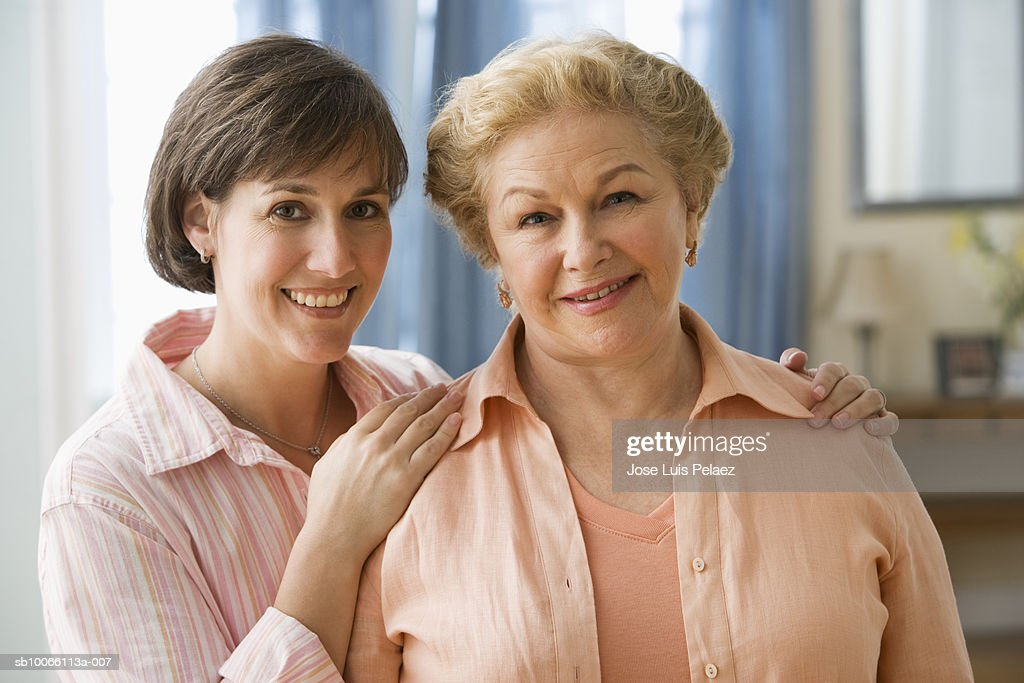 Mother and daughter smiling, portrait, close-up : Stock Photo