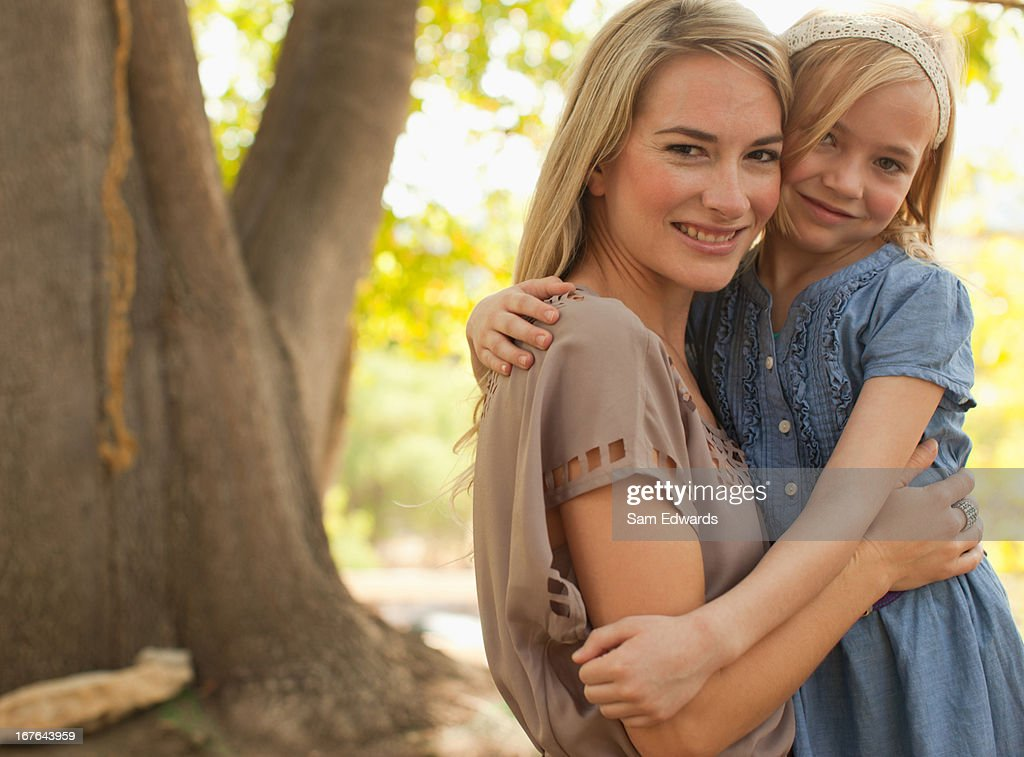 Mother and daughter standing together : Stock Photo
