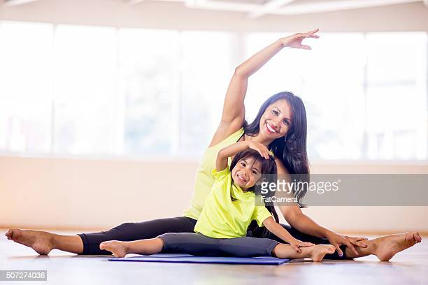 Mother and Daughter Stretching at the Gym