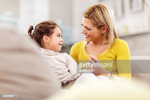 Mother and daughter talking at home. : Stock Photo