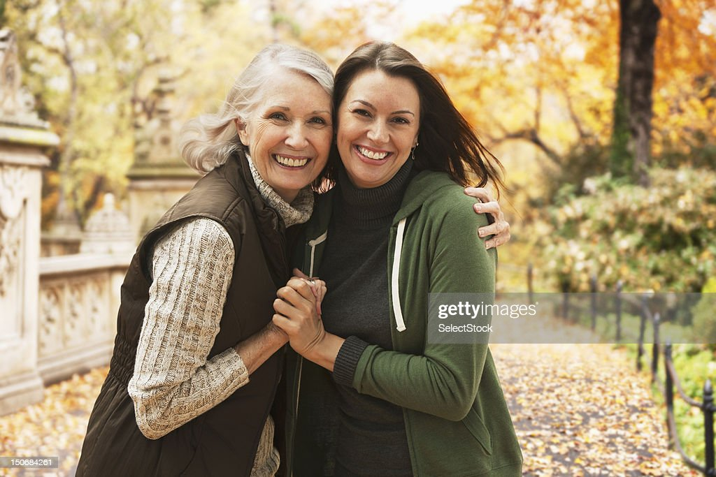 Mother and daughter together outdoors : Stock Photo
