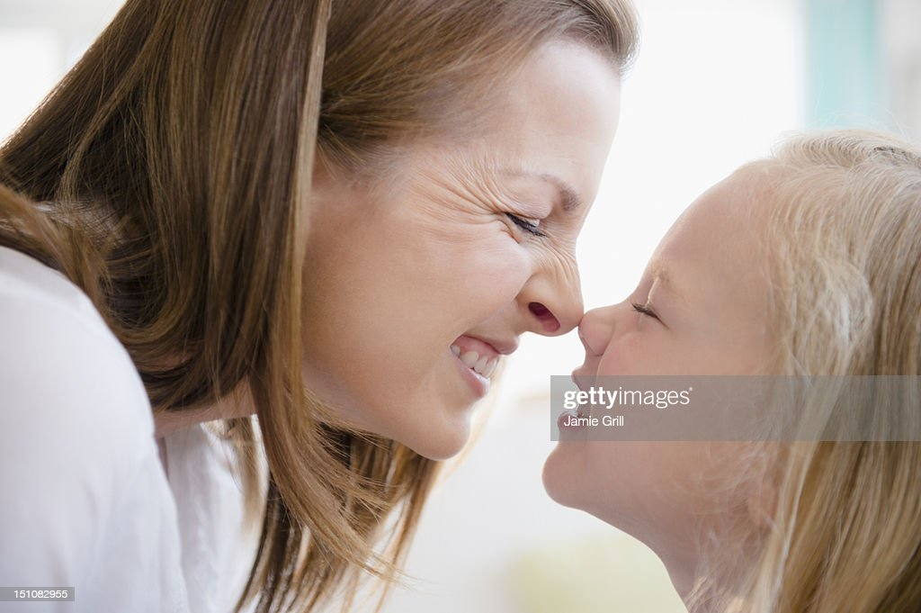 Mother and daughter touching noses