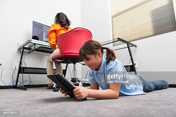 Mother and daughter using technology in home office