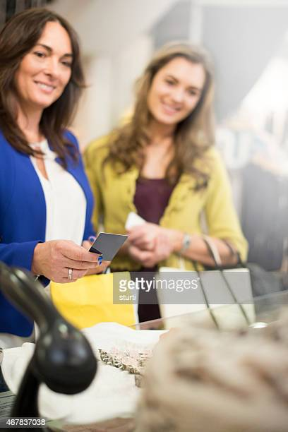 mother and daughter using their store card