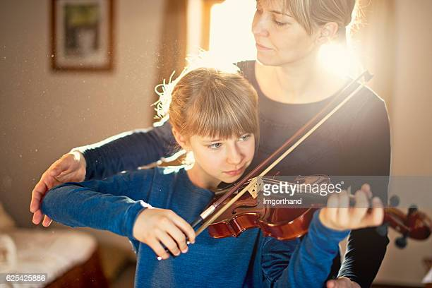 Mother and daughter violin lesson