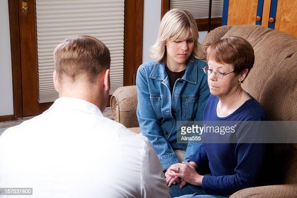 Mother and daughter visiting doctor, counselor or therapist