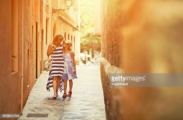 Mother and daughter visiting mediterranean city of Palma