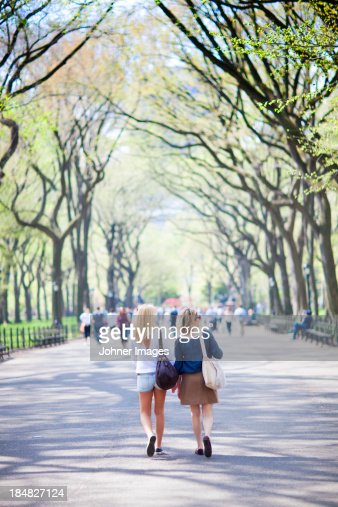 Mother and daughter walking in Central Park